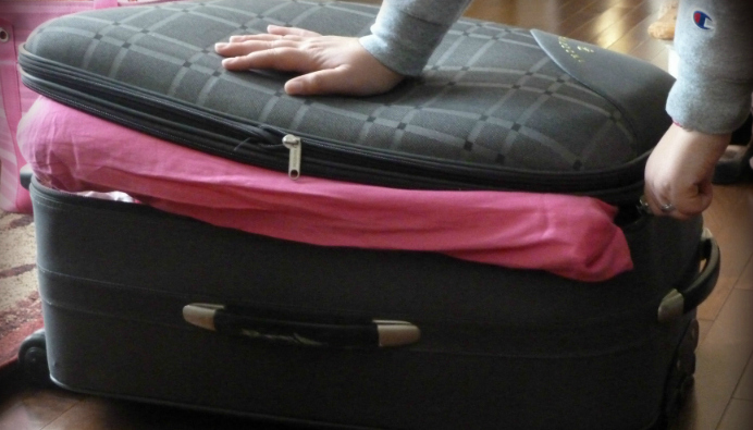 The Overfilled Suitcase